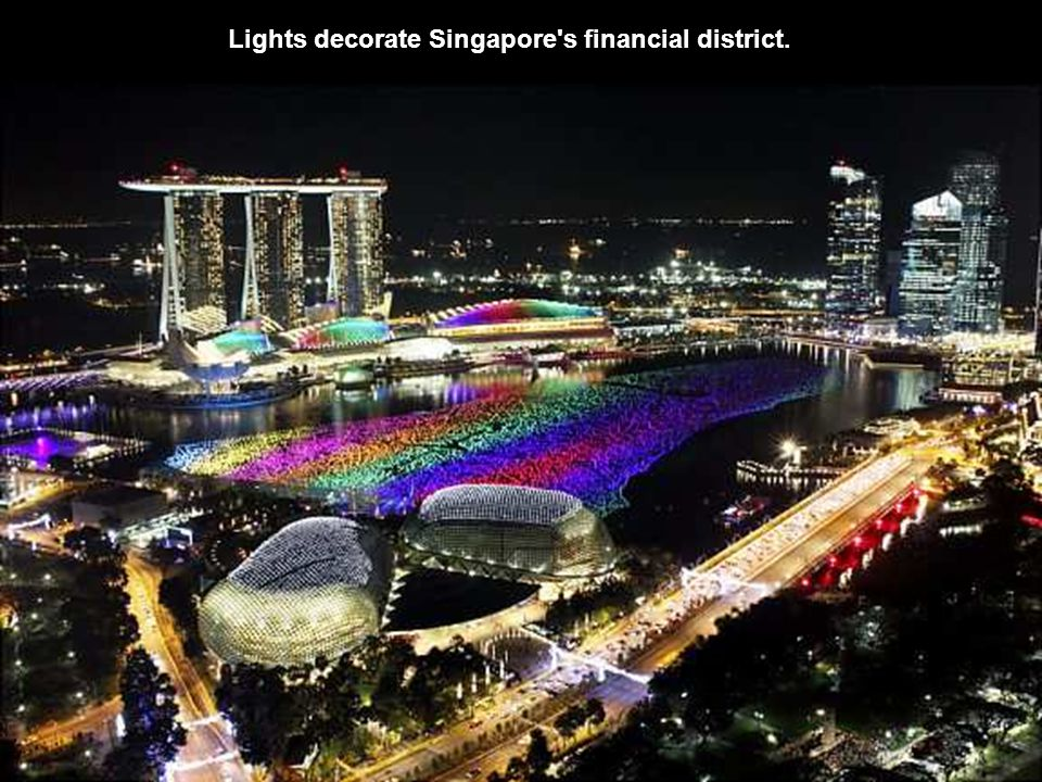 Lights decorate Singapore s financial district.