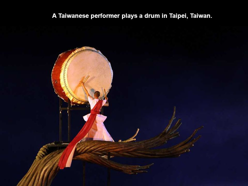 A Taiwanese performer plays a drum in Taipei, Taiwan.