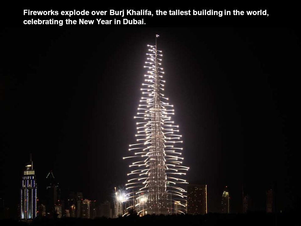 Fireworks explode over Burj Khalifa, the tallest building in the world, celebrating the New Year in Dubai.