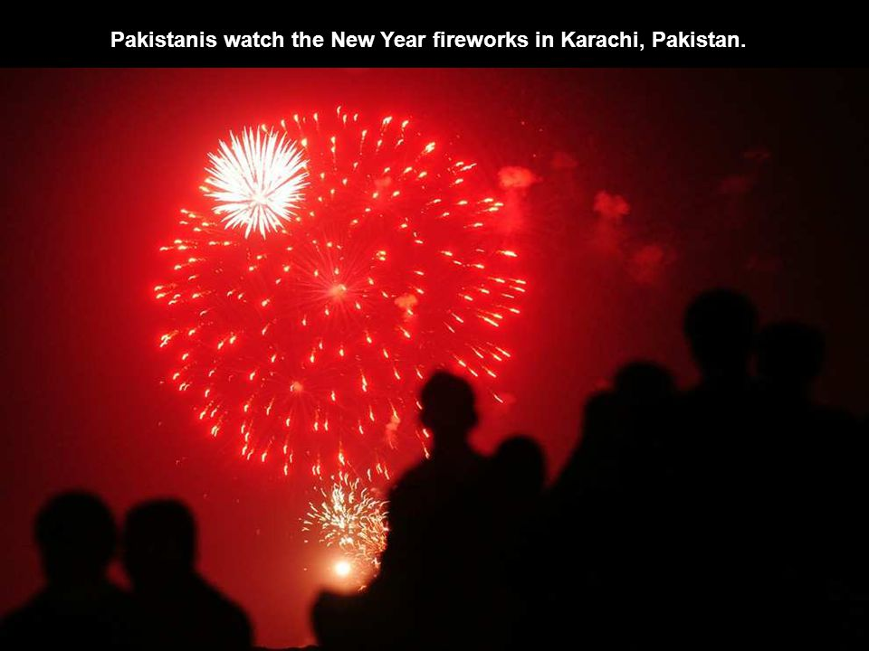Pakistanis watch the New Year fireworks in Karachi, Pakistan.