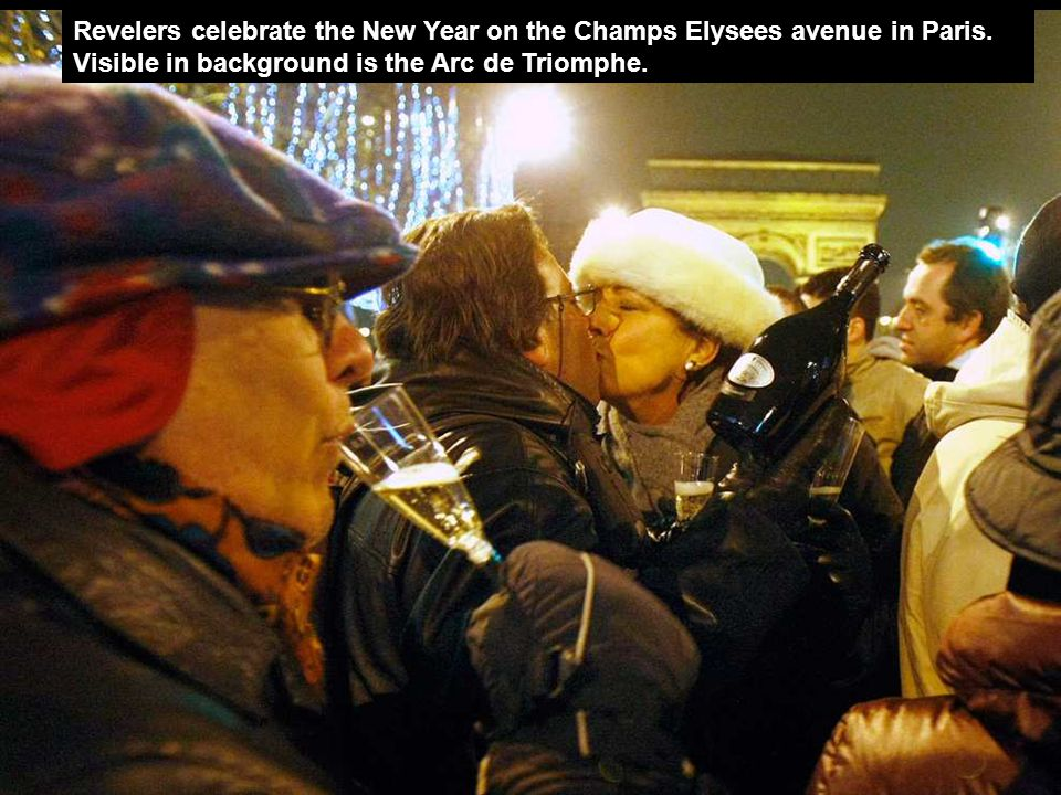Revelers celebrate the New Year on the Champs Elysees avenue in Paris
