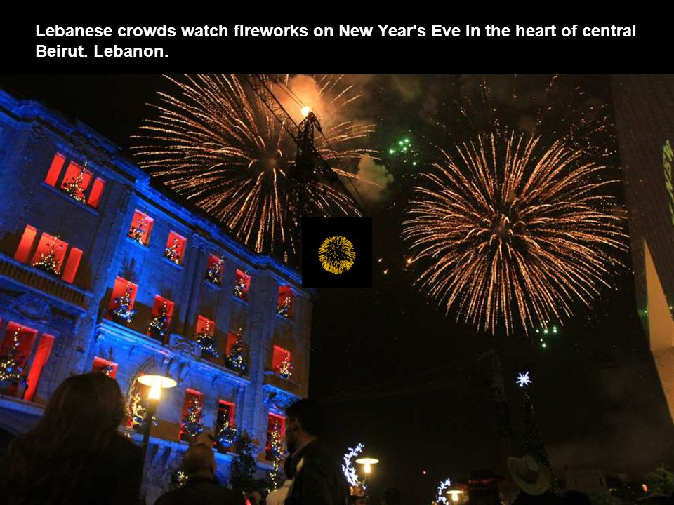 Lebanese crowds watch fireworks on New Year s Eve in the heart of central Beirut. Lebanon.