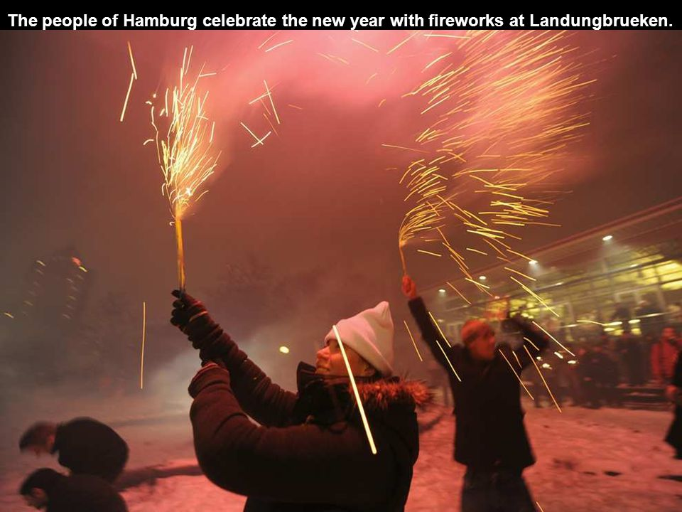 The people of Hamburg celebrate the new year with fireworks at Landungbrueken.