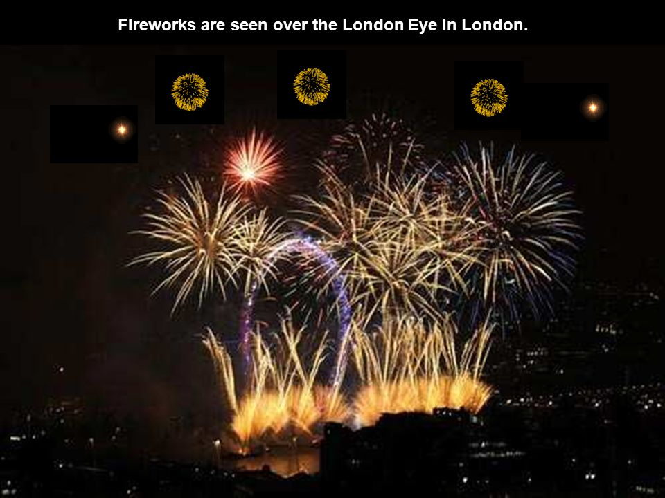 Fireworks are seen over the London Eye in London.