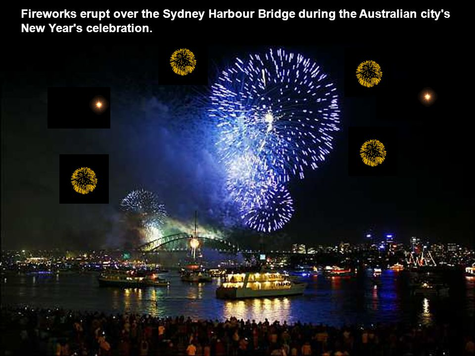 Fireworks erupt over the Sydney Harbour Bridge during the Australian city s New Year s celebration.