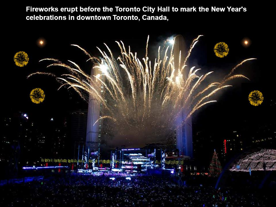 Fireworks erupt before the Toronto City Hall to mark the New Year s celebrations in downtown Toronto, Canada,