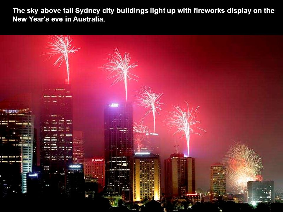 The sky above tall Sydney city buildings light up with fireworks display on the New Year s eve in Australia.