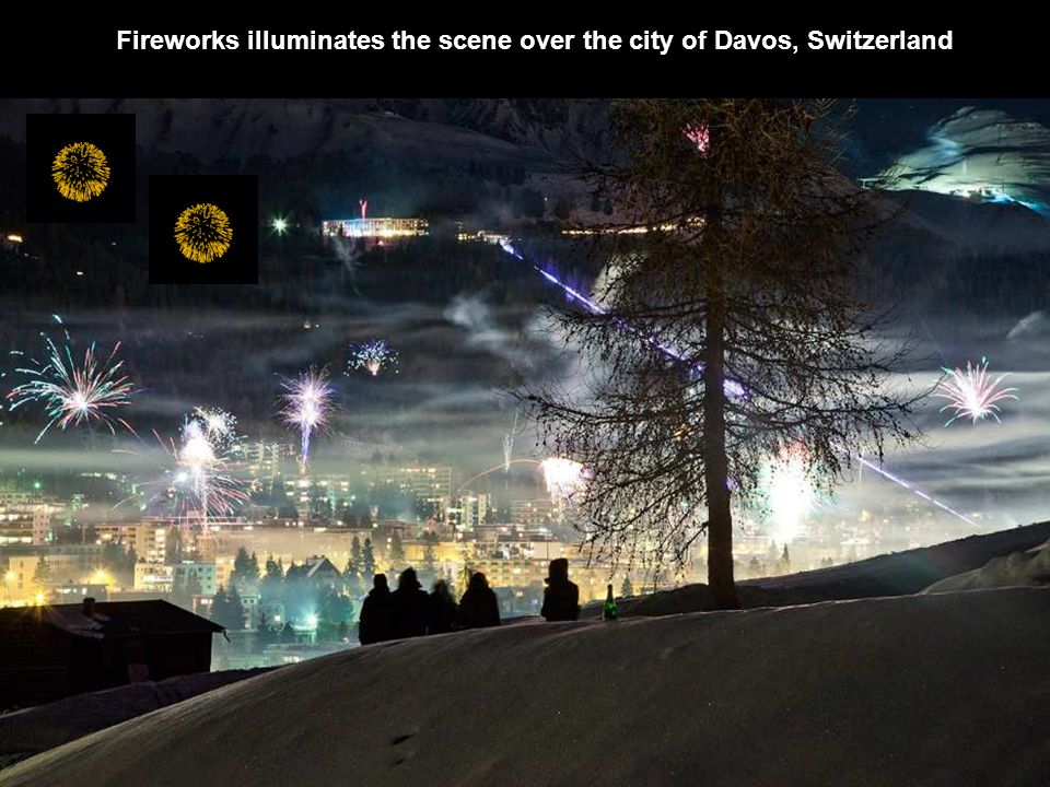 Fireworks illuminates the scene over the city of Davos, Switzerland