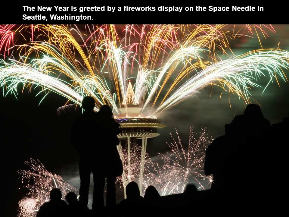 The New Year is greeted by a fireworks display on the Space Needle in Seattle, Washington.