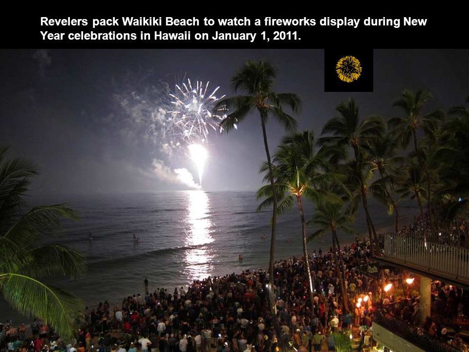 Revelers pack Waikiki Beach to watch a fireworks display during New Year celebrations in Hawaii on January 1, 2011.