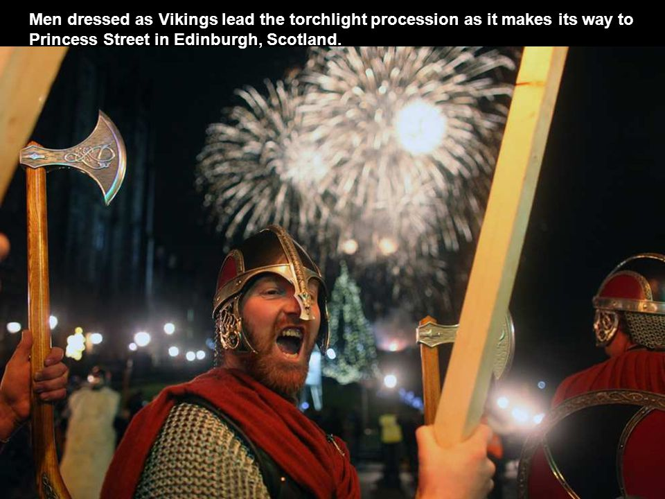 Men dressed as Vikings lead the torchlight procession as it makes its way to Princess Street in Edinburgh, Scotland.