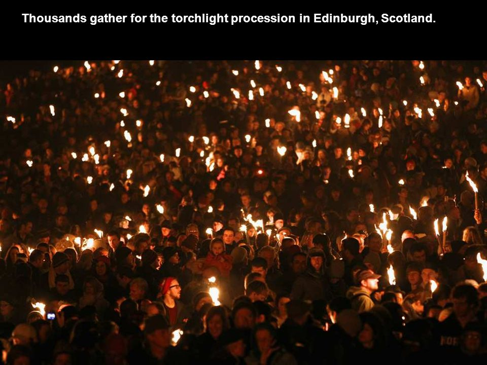 Thousands gather for the torchlight procession in Edinburgh, Scotland.