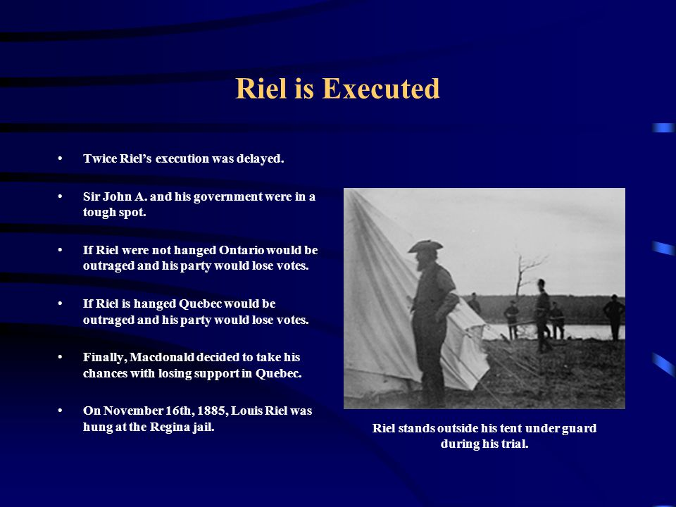 Riel stands outside his tent under guard during his trial.