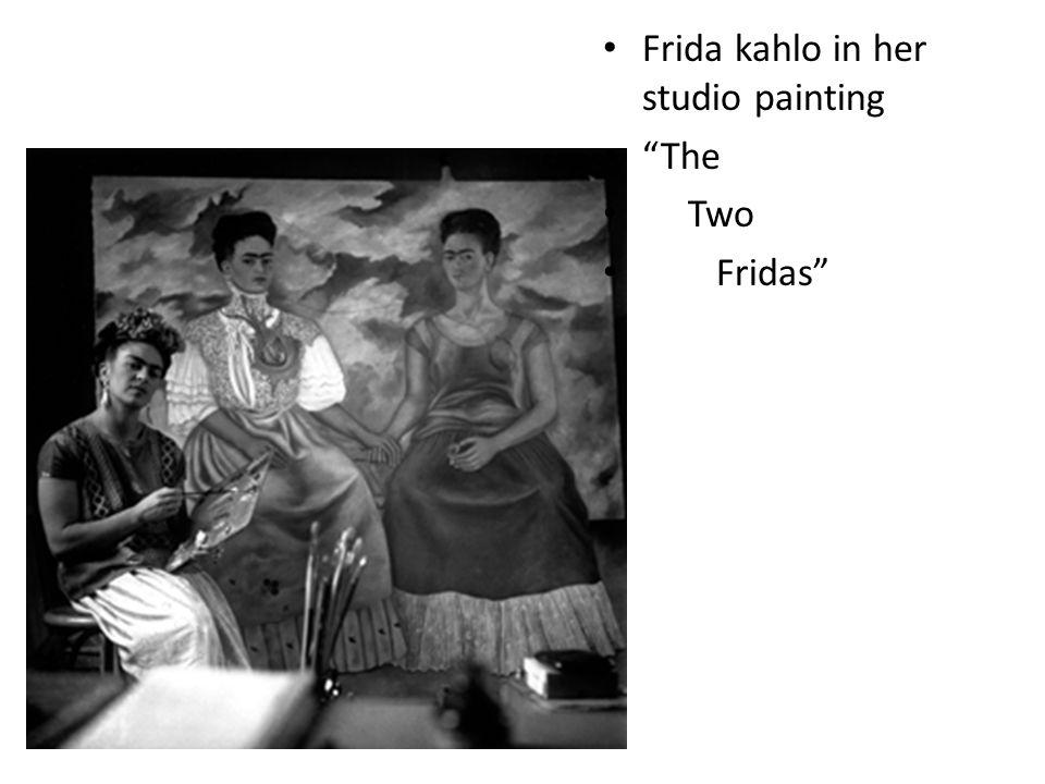 Frida kahlo in her studio painting