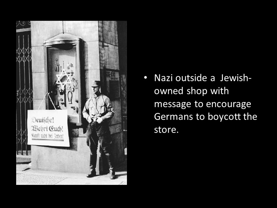 Nazi outside a Jewish-owned shop with message to encourage Germans to boycott the store.