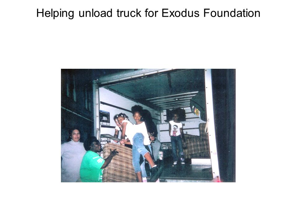 Helping unload truck for Exodus Foundation