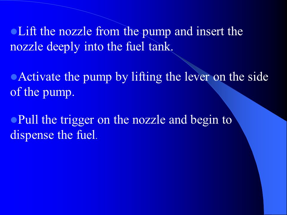 Lift the nozzle from the pump and insert the nozzle deeply into the fuel tank.