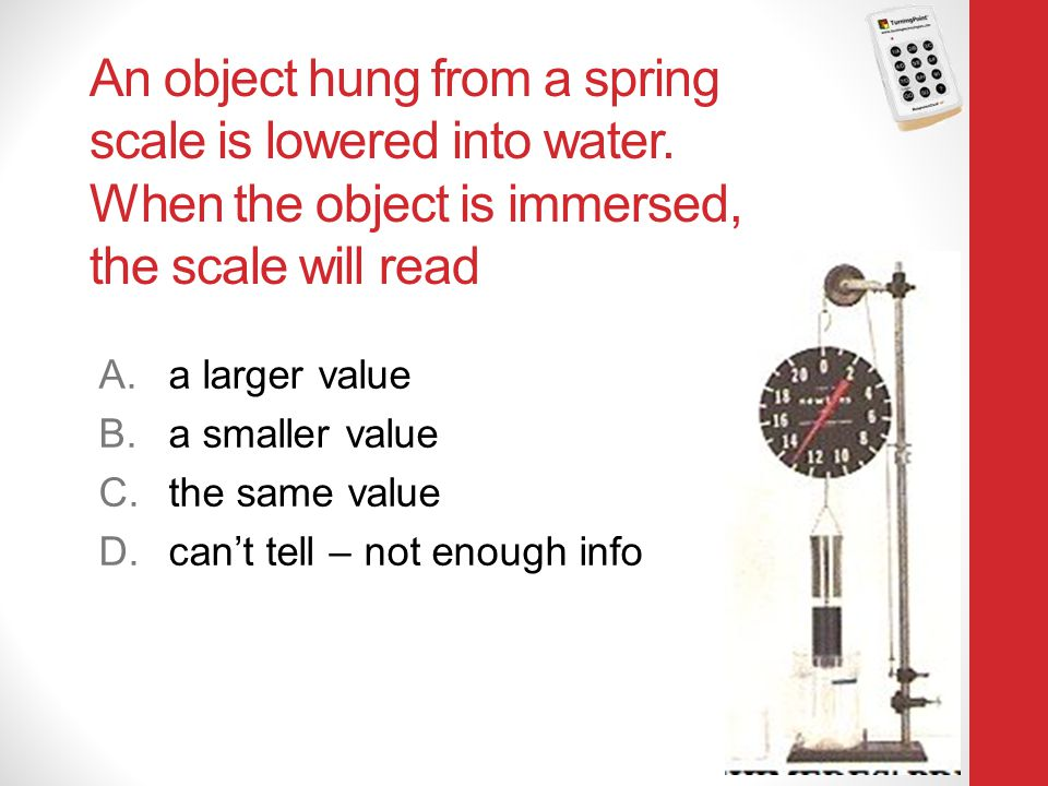 An object hung from a spring scale is lowered into water