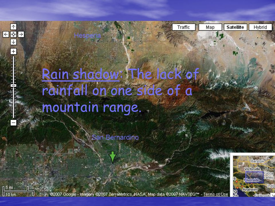 Rain shadow: The lack of rainfall on one side of a mountain range.