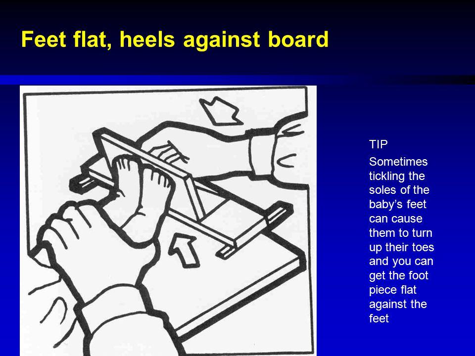 Feet flat, heels against board
