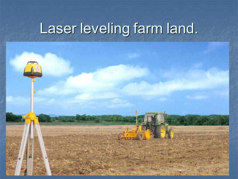 Laser leveling farm land.