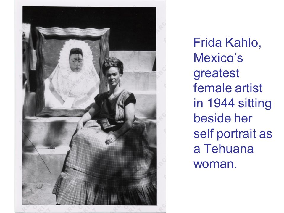 Frida Kahlo, Mexico's greatest female artist in 1944 sitting beside her self portrait as a Tehuana woman.