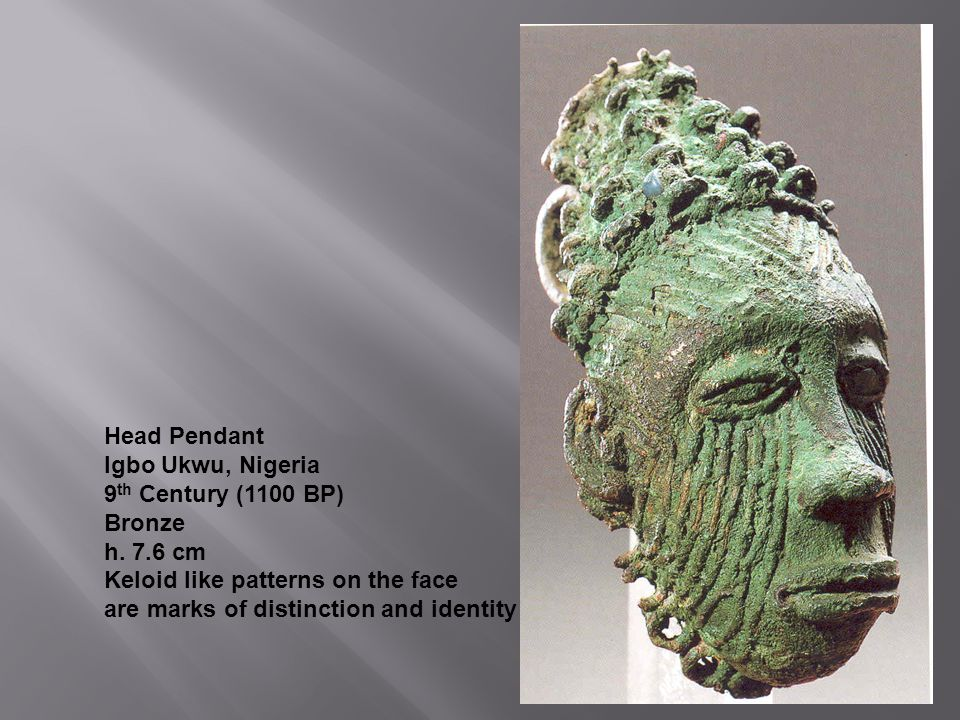 Head Pendant Igbo Ukwu, Nigeria. 9th Century (1100 BP) Bronze. h. 7.6 cm. Keloid like patterns on the face.