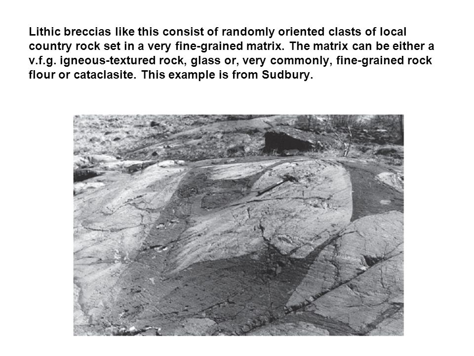 Lithic breccias like this consist of randomly oriented clasts of local country rock set in a very fine-grained matrix.