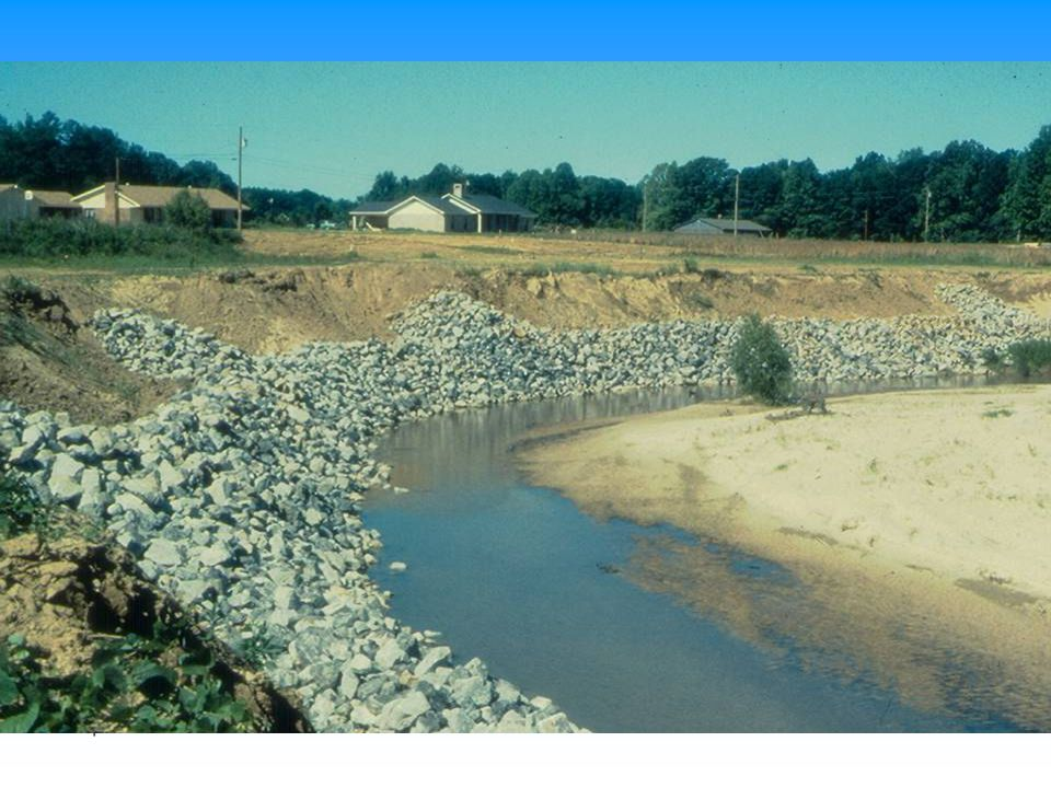 This is example of riprap on lower bank only in zone where attack is most frequent and most intense. Rock toe is intended to launch or fall down the slope as scour occurs on the channelward side of the riprap.