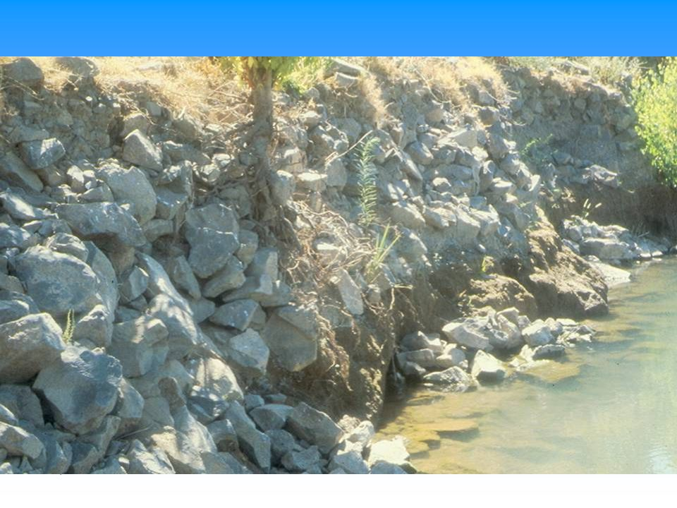 Example of local failure of riprap at toe of slope