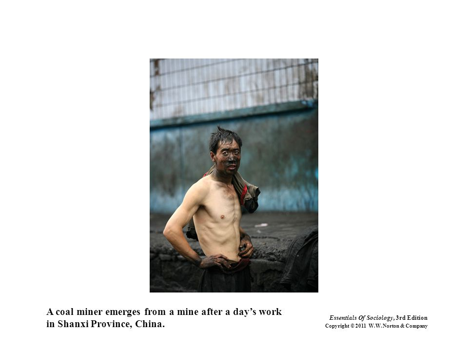 A coal miner emerges from a mine after a day's work