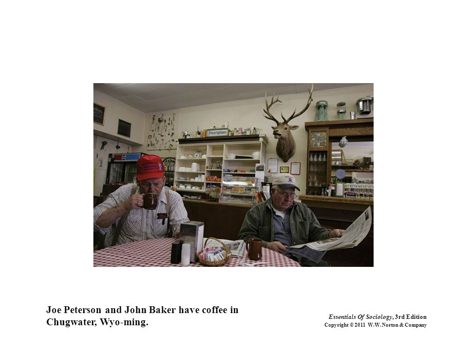 Joe Peterson and John Baker have coffee in Chugwater, Wyo-ming.