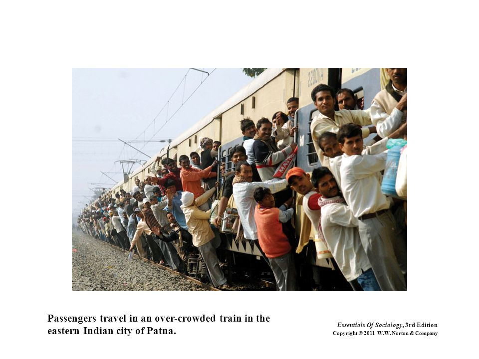 Passengers travel in an over-crowded train in the