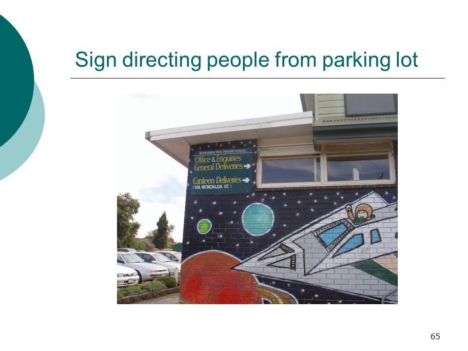Sign directing people from parking lot