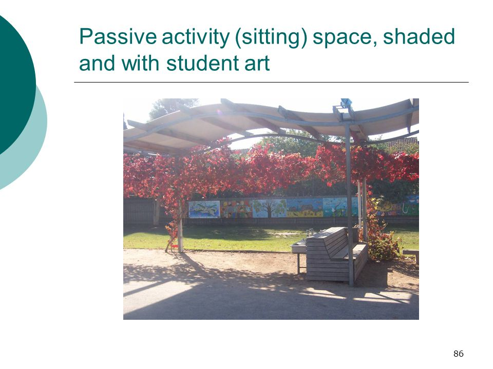 Passive activity (sitting) space, shaded and with student art