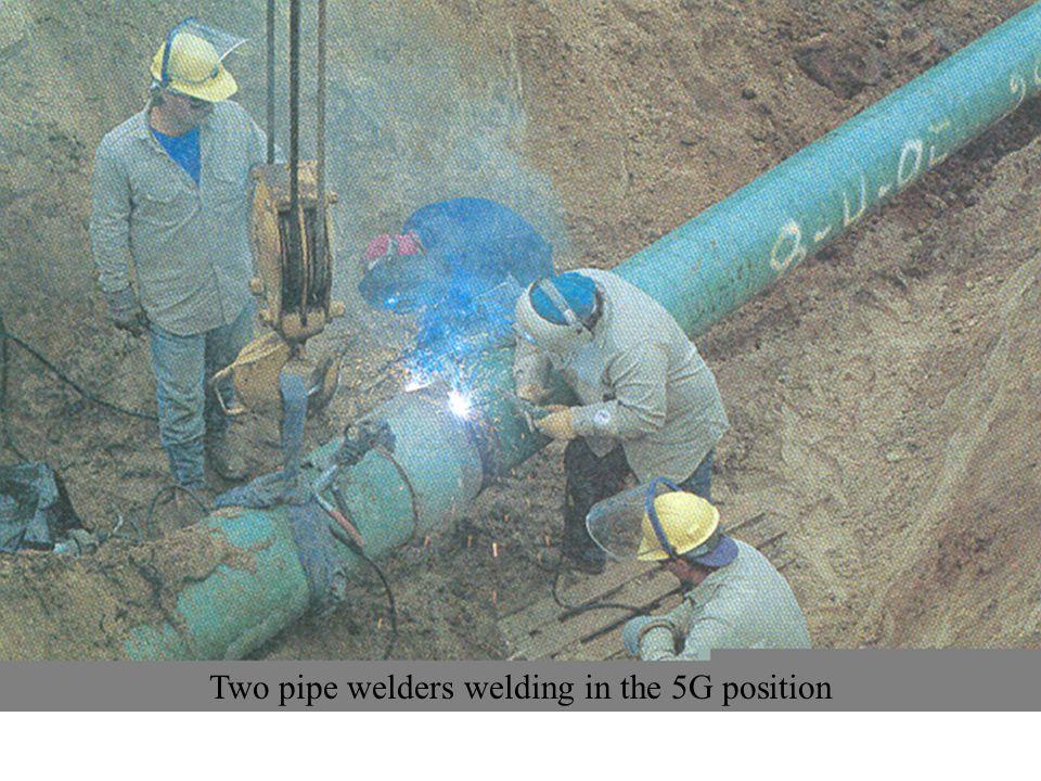 Two pipe welders welding in the 5G position