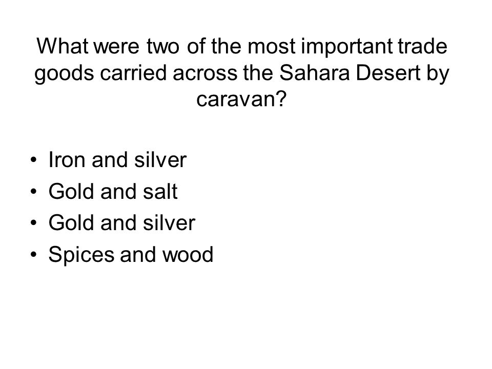 What were two of the most important trade goods carried across the Sahara Desert by caravan