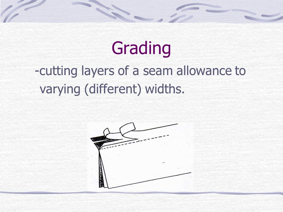 Grading -cutting layers of a seam allowance to