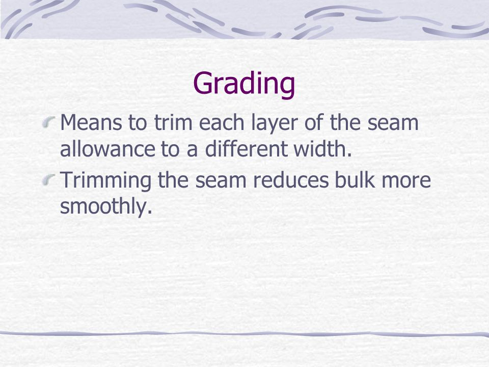 Grading Means to trim each layer of the seam allowance to a different width.
