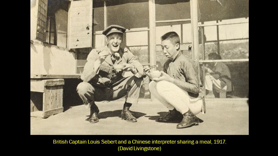 British Captain Louis Sebert and a Chinese interpreter sharing a meal, 1917.