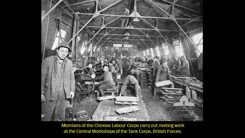 Members of the Chinese Labour Corps carry out riveting work