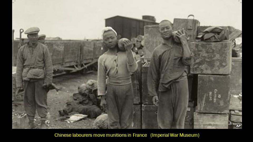 Chinese labourers move munitions in France (Imperial War Museum)