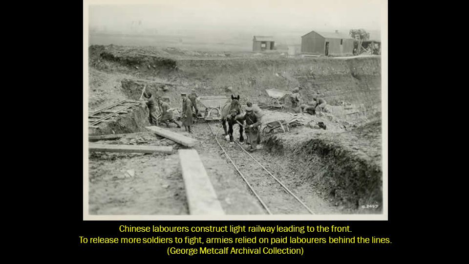 Chinese labourers construct light railway leading to the front.