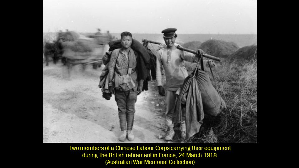 Two members of a Chinese Labour Corps carrying their equipment