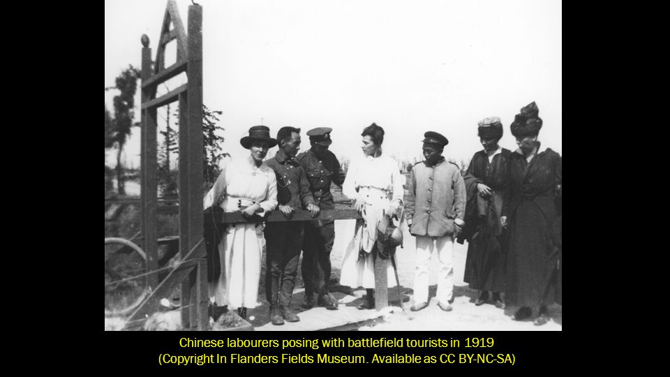 Chinese labourers posing with battlefield tourists in 1919