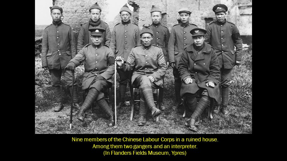 Nine members of the Chinese Labour Corps in a ruined house.
