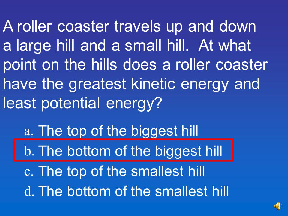 A roller coaster travels up and down a large hill and a small hill