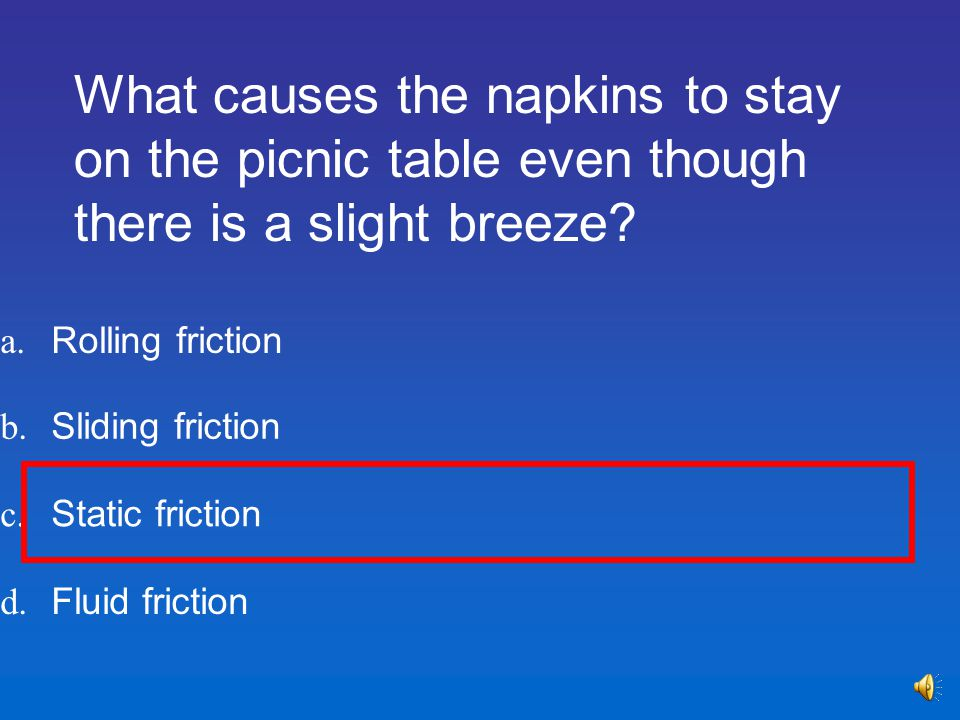 What causes the napkins to stay on the picnic table even though there is a slight breeze