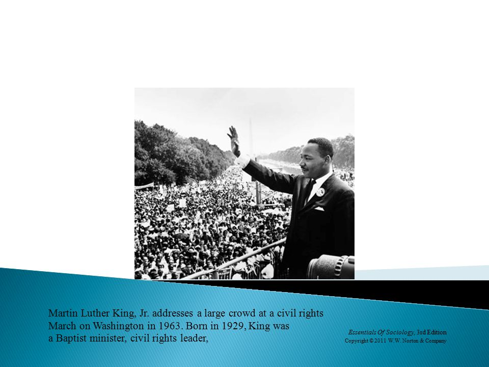 Martin Luther King, Jr. addresses a large crowd at a civil rights