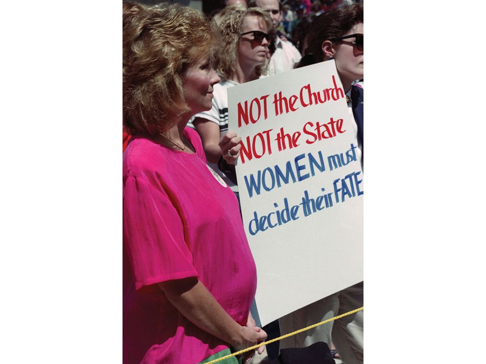 fig26_18.jpg Page 1053: Demonstrators at a rally supporting abortion rights.